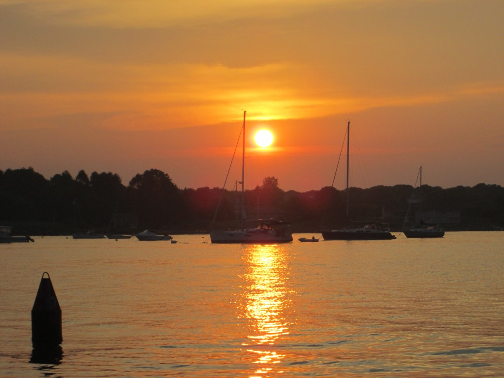 View of the sun setting over Stonington Harbor from Harboredge